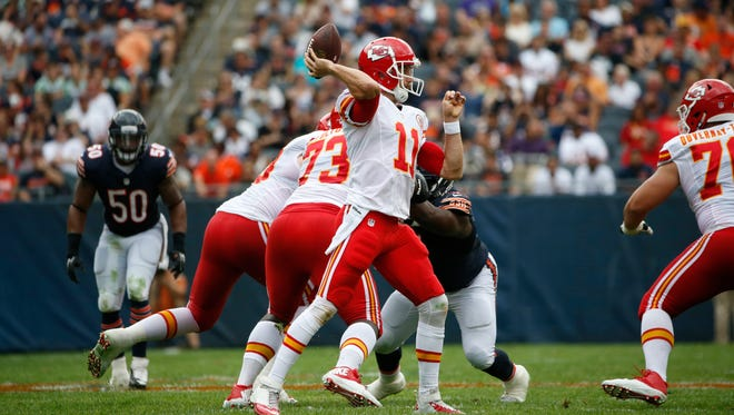 Kansas City Chiefs quarterback Alex Smith (11) throws a pass during the first half of an NFL preseason football game against the Chicago Bears, Saturday, Aug. 27, 2016, in Chicago.