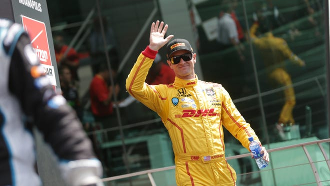 Saturday May 10th, 2014, Ryan Hunter-Rey waves to fans during driver introductions at the inaugural Grand Prix of Indianapolis at the Indianapolis Motor Speedway.