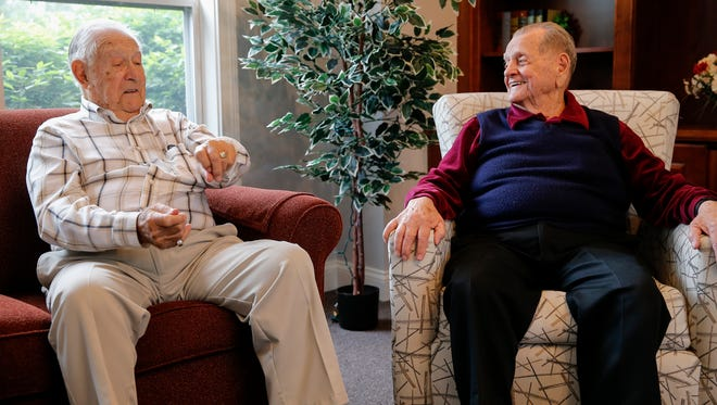 Paul LaHue, 94, left, and Walt Stroud, 90, both of West Chester Township, served in World War II, and live just minutes apart but never met each other until a recent meeting.