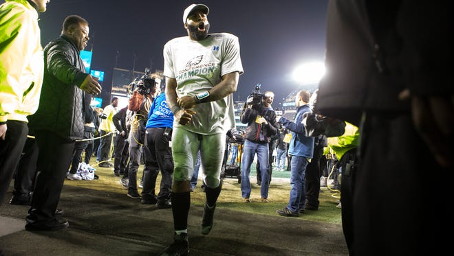 Eagles' Malcolm Jenkins yells as he walks into the tunnel Sunday at Lincoln Financial Field.