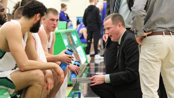 York College head coach Matt Hunter talks to his team during a recent NCAA Division III Tournament game against Hamilton College in York.