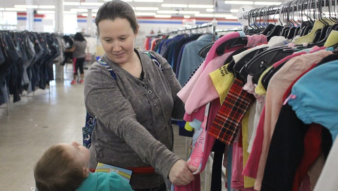 """Tonya Hensel, of Marion, shops Monday at the Salvation Army Thrift Store's new location in the Marion Plaza Shopping Center on Mount Vernon Avenue. She says it's """"a lot nicer and not as cluttered"""" as the previous location."""