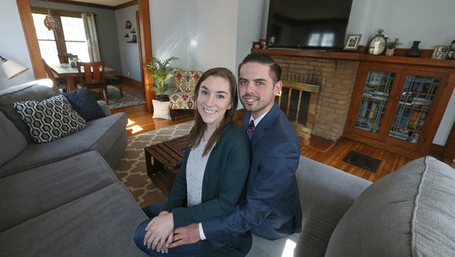 Alanna Barnes and Sean Meritt in the living room of their new home on Melville Street, in the North Winton Village neighborhood in Rochester, Monday, May 7, 2018.