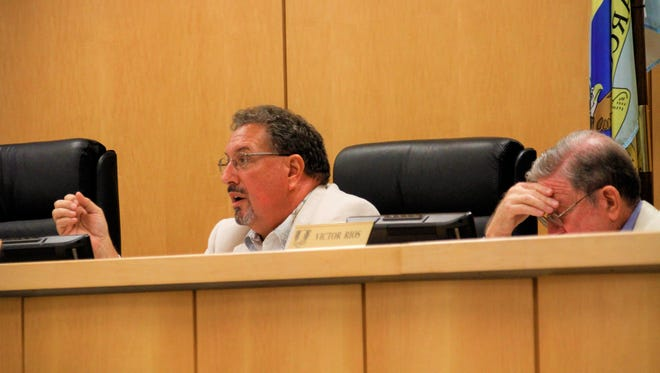 Councilor Howard Reed, center, proposes that Marco Island utilize internal resources to aid in finding a city manager.
