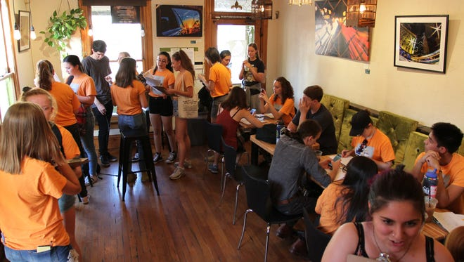 Dozens of Arizona high-school students with March for Our Lives Phoenix gathered in downtown Phoenix at Songbird Coffee and Tea House, near Roosevelt Street and Third Avenue, to sign up new voters on Friday.