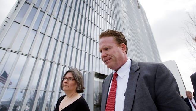 St. George  businessman Jeremy Johnson leaves the Federal Courthouse Friday, March 25, 2016, in Salt Lake City. Johnson who was a helicopter-flying philanthropist before he became a key figure in an influence-peddling scandal that ensnared two former state attorneys general was convicted of making false statements to banks but cleared of dozens of other charges.