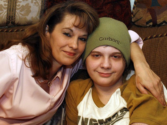 Brande Brewer poses with her son Brandon Brewer, then