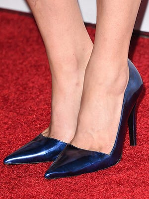 File photo of actress in high heeled shoes walking the red carpet.