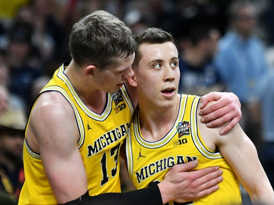 Michigan forward Moritz Wagner, left,  and Michigan guard Duncan Robinson hug in the last minute of the second half against Loyola-Chicago.