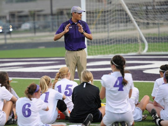Wylie coach Manuel Cordova talks to his team during
