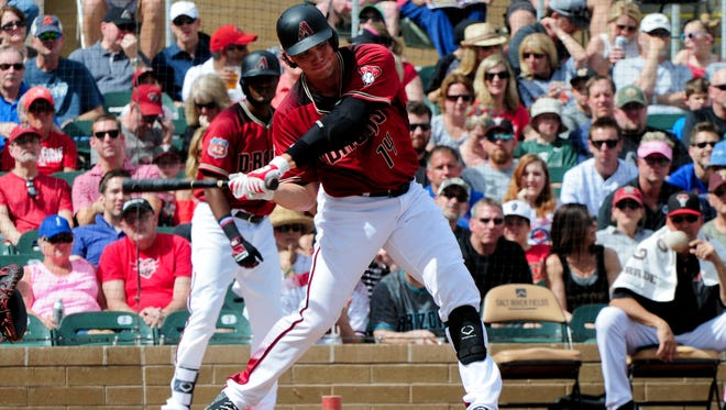 March 6, 2016: Arizona Diamondbacks slugger Peter O'Brien (14) hits an RBI single in the first inning against the Chicago Cubs at Salt River Fields at Talking Stick.