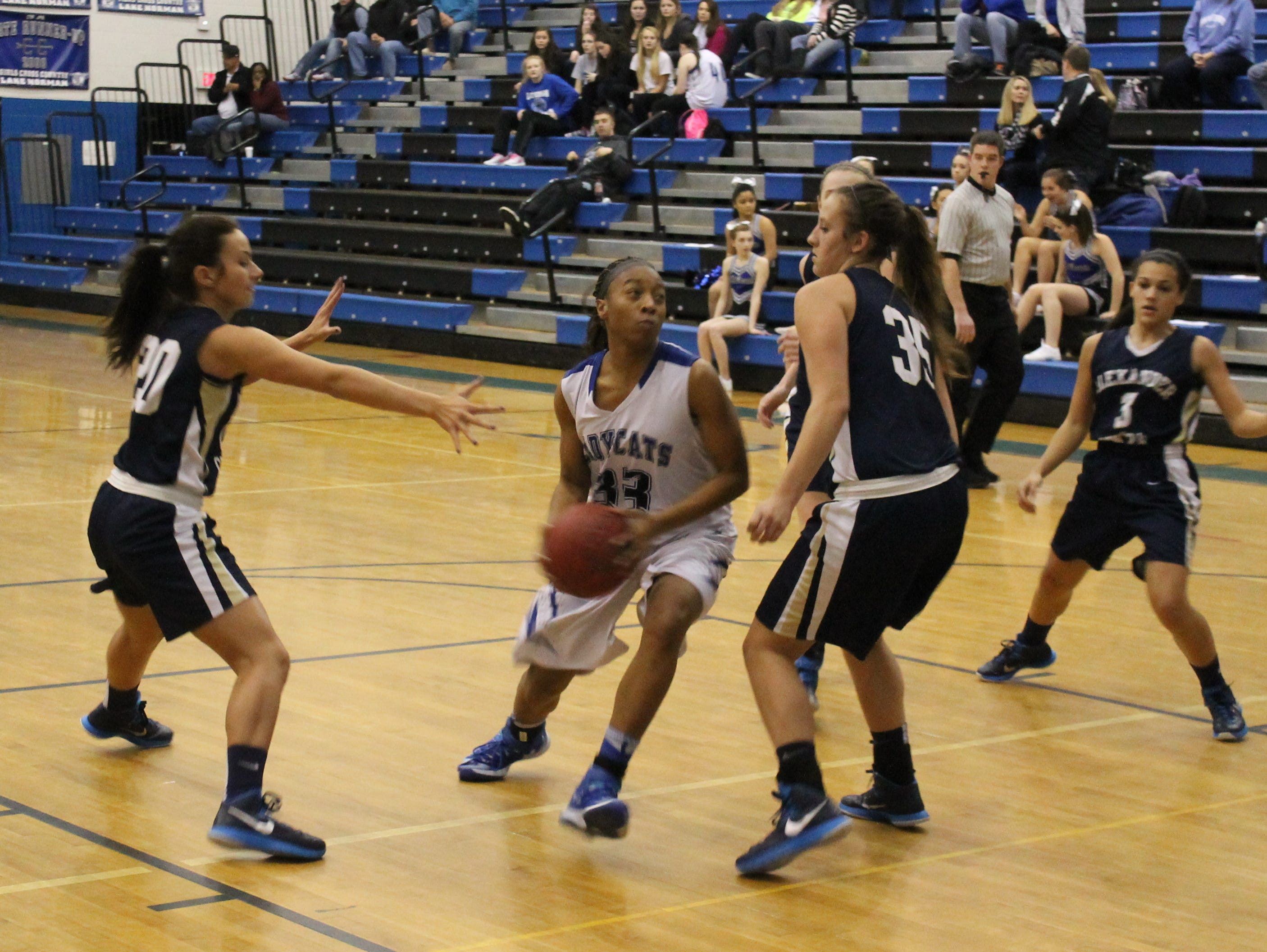 Lake Norman's Bri Harris-Young attempts to break up an Alexander Central double team.
