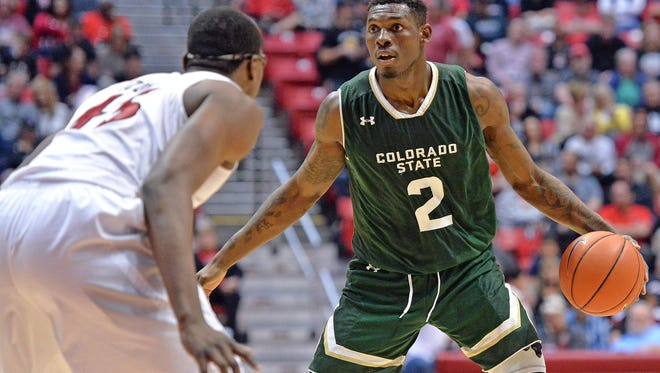 CSU's Emmanuel Omogbo works against San Diego State defender Valentine Izundu during a Jan. 28 game in San Diego. Omogbo had his second double-double in as many games Thursday at the Portsmouth Invitational, a showcase event for the nation's top pro prospects.