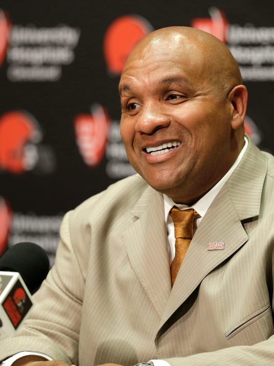 Cleveland Browns head coach Hue Jackson smiles as he answers questions during a news conference, Wednesday, Jan. 13, 2016, in Berea, Ohio. Jackson has experience as a head coach, knows the AFC North and has fixed quarterbacks. Jackson, who waited four years for his second crack at leading an NFL team, has been hired as Cleveland's next coach, the struggling franchise's eighth since 1999 and sixth since 2008. (AP Photo/Tony Dejak)