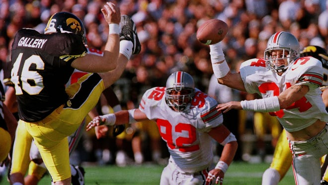 Newark Catholic graduate Rob Kelly blocks a punt for Ohio State during a 1996 victory against Iowa.