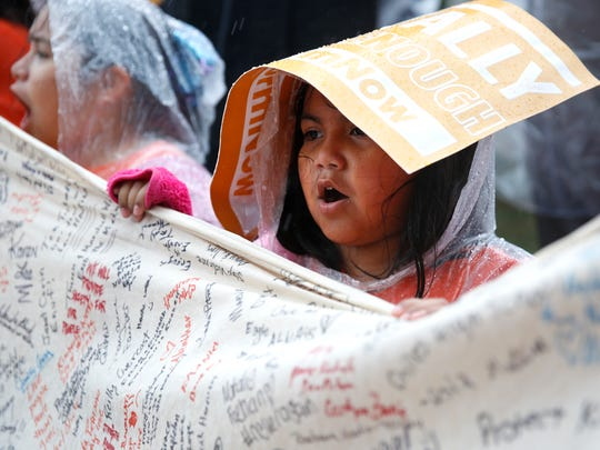 Delayla Gasca, 7, joined hundreds of other protesters