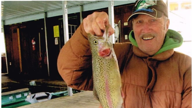 Ken White with a nice rainbow trout caught on Lake Taneycomo, one of the many streams in Missouri that provide trout fishing.