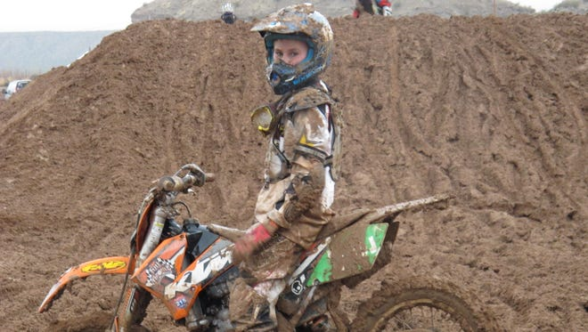A young USRA racer pauses in frustration after his bike stalls out at the Mesquite MX Park.