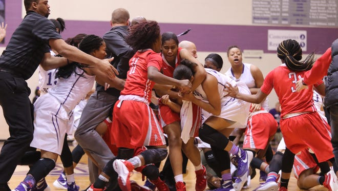 Freelance photographer Albert Aguirre captured an on-court brawl on Jan. 16, 2016 that involved players from Pike and Ben Davis and spectators.