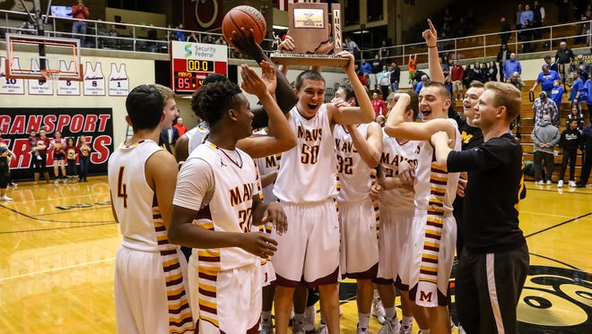 The McCutcheon team celebrates as they clam the regional championship at Logansport. Saturday, March 12, 2016.