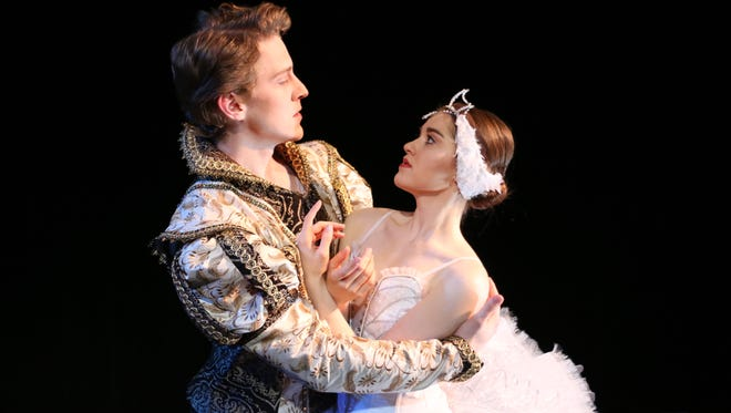"""CCM students Madison Holschuh and Sam Jones performing the roles of Odette and Prince Siegfried in the College-Conservatory of Music Department of Dance 's production of """"Swan Lake,"""" being presented April 22-24."""