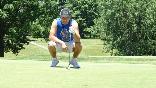 Braxton Tea of Bucyrus, a recent Wynford grad who is heading to Marion Tech this fall, lines up a put on Friday at the Bucyrus Golf Club.