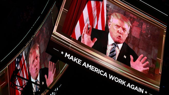 Donald Trump delivers an address via video to delegates on the second day of the Republican National Convention at Quicken Loans Arena in Cleveland.