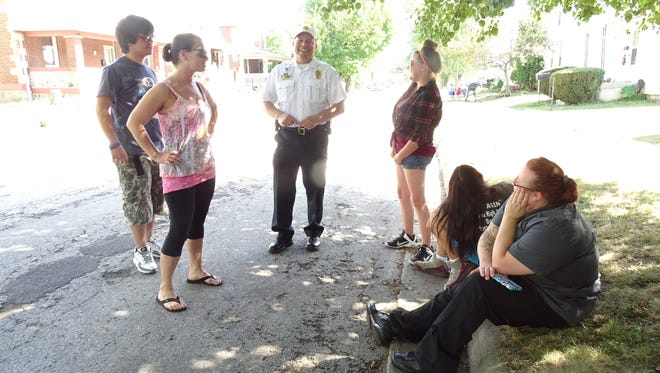 Bucyrus police Chief David Koepke laughs with city residents during the 2016 National Night Out celebrations.