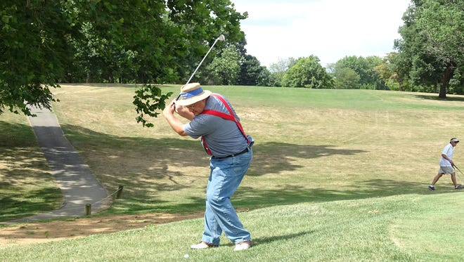 Dennis Miller of Wyandot chips a ball on to the green Thursday afternoon at the Golf Club of Bucyrus.