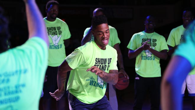 FGCU men's basketball sophomore Rayjon Tucker dances with the men's basketball team during Wednesday night's FGCU Eagle Revolution at Alico Arena.