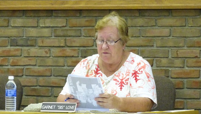 """Bucyrus City Council President Garnet """"Sis"""" Love looks over paperwork regarding Americans with Disabilities Act regulation Monday during the city's Health and Safety Committee meeting."""