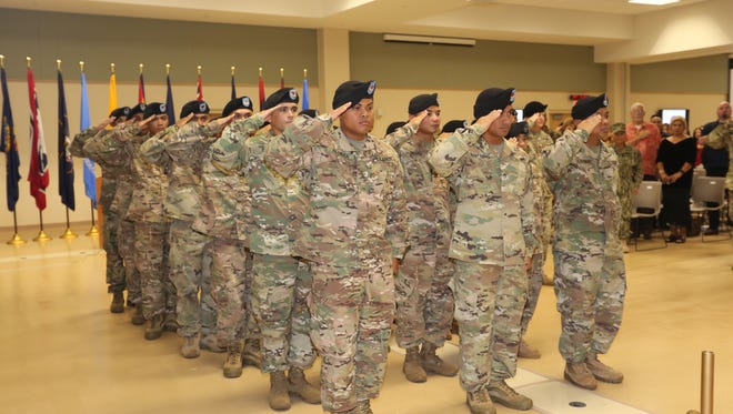 Army Reserve soldiers with Detachment 5, 368th Military Police, 9th Mission Support Command, are shown during their deployment ceremony on  Sept. 24, at the Guam Army National Guard Assembly Hall.