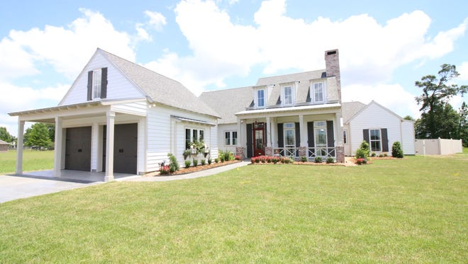 This 4 bedroom, 4 1/2 bath home has 3,135 square feet of living area and is located at 110 Thames in the Grand Pointe Subdivision. It is listed for $635,000.