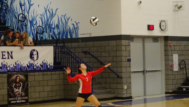 Claire Songer serves in the second game of the match against Carey on Thursday night. The Buckettes won 3-1 to stay undefeated.