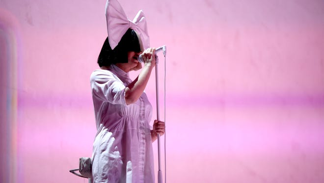 Sia performs at the 2016 iHeartRadio Music Festival at  Las Vegas' T-Mobile Arena on September 23, 2016.