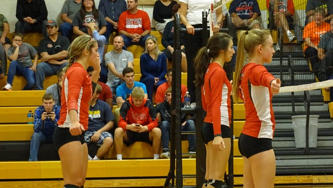 Jenna Karl (left), Emily Stump (center), Addison Ackerman (right) and the rest of the Buckettes have a tricky week ahead .