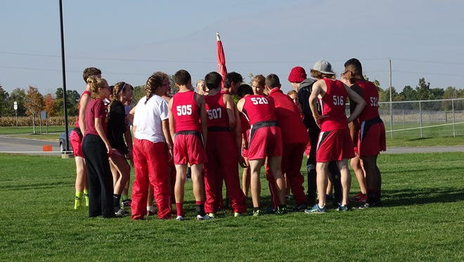 The Bucyrus cross country team huddles together at the N10 championship a couple weeks ago.