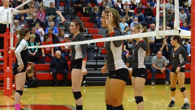 Sarah Heydinger (left), Jenna Karl (left center), Addison Ackerman (right center) and Claire Songer (right) wait for South Central to return the serve in the second game.