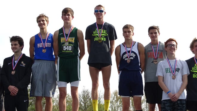 Chad Johnson stands atop the podium after taking first place in the regional meet at Hedges-Boyer Park.