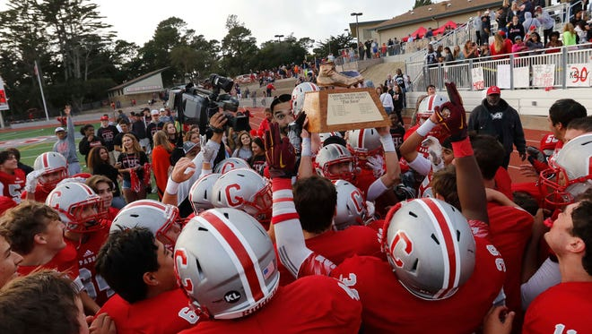 Carmel hoists up the Shoe Trophy after defeating Pacific Grove in the annual Shoe football game at Carmel High on Saturday, November 5, 2016 in Carmel, Calif. -- Vernon McKnight/for The Californian