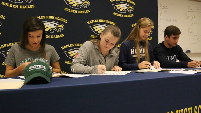 Naples athletes sign with Division I programs during Wednesday morning's early college signing ceremony for four Naples athletes in the Naples High School cafeteria.