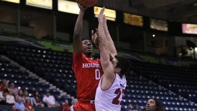 Danrad Knowles shots the ball during the first half of the Gulf Coast Showcase semifinal between Houston and South Dakota on Tuesday, Nov. 22, 2016.