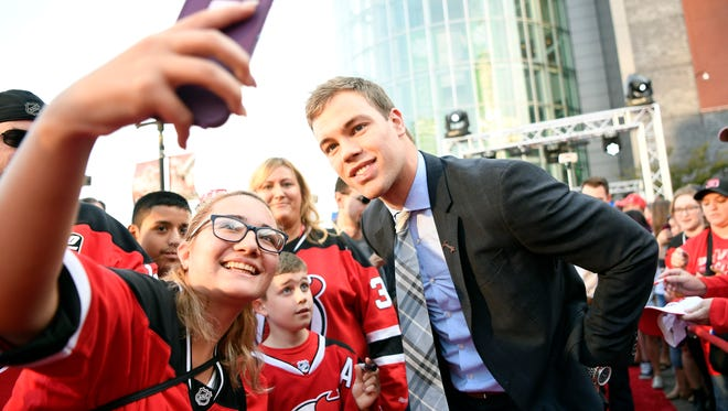 Devils star Taylor Hall, here posing with fans at Newark in October, returned to the ice for the Devils morning skate Friday, Nov. 25, 2016, which was ahead of schedule after the first-year Devil had knee surgery earlier this month. File photo: DANIELLE PARHIZKARAN/STAFF PHOTOGRAPHER.