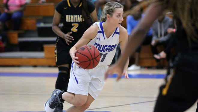 Barron Collier's Megan Mosbach drives toward the basket in the girls Bokamper's Turkey Shoot Tournament title game between the Cougars and American Heritage at Barron Collier High School on Saturday, Nov. 26, 2016.