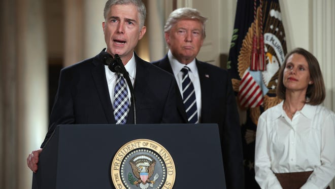 Judge Neil Gorsuch delivers brief remarks after being nominated by U.S. President Donald Trump to the Supreme Court with his wife, Marie Louise Gorshuch, during a ceremony in the East Room of the White House.
