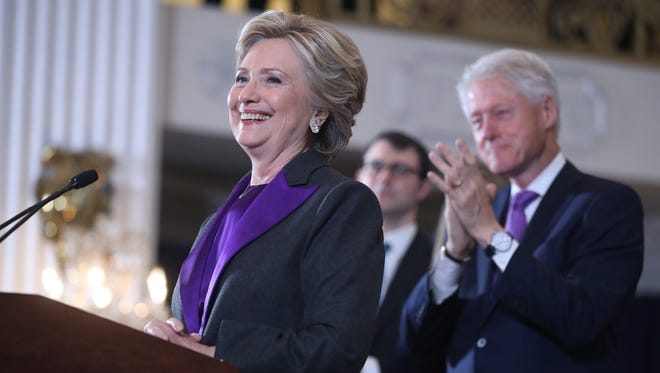 Former President Bill Clinton applauds as his wife, Democratic presidential candidate Hillary Clinton, speaks in New York on Nov. 9, 2016. Clinton conceded the presidency to Donald Trump in a phone call.