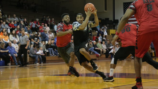 """Former All-Big Ten cornerback Antonio Brown drives in a celebrity basketball game featuring former Ohio State football players that preceded the 39th News Journal All-Star Classic. Smith is part of a fraternity that has earned OSU the name """"DBU."""""""