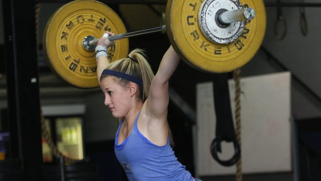 19 year-old Shannon McNames does weightlifting squats while training at Cross Fit in West Chester, Pa. A West Chester University sophomore, McNames just made the U.S. team for weightlifting at the 2017 World University Games in Chinese Taipei in the 48-kilogram class (just 105 pounds).