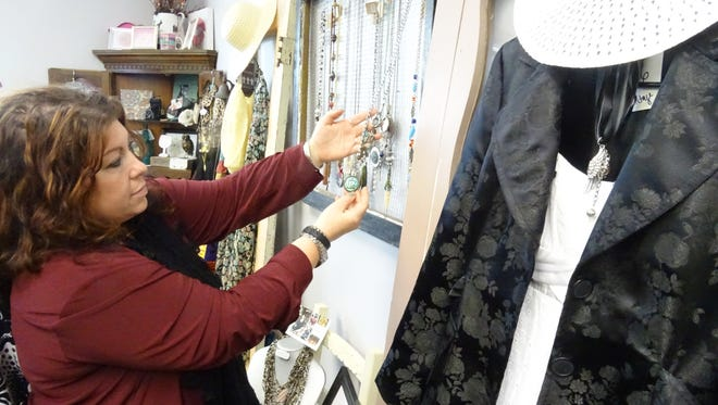 Ally Suter shows off some of the jewelry she makes by hand and sells in her boutique, 2 Begin Again, in Bucyrus.