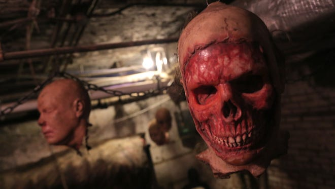 Fake heads hang from the ceiling in the butcher room at the Escape from Blood Prison at the Ohio State Reformatory. The haunted walk will be open during the Ink in the Clink.